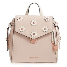 michael  small flower embellished leather backpack by Michael Kors. Contrast flower appliques centered by polished dome studs punctuate the flap of a boxy little backpack. A convenient magnetic back pocket makes a perfect place to stash your phone for quick check-ins on the go. Style Name: Michael Michae... #michaelkors #bags