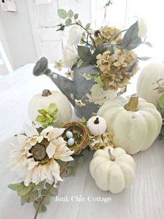 If white is your color you want to see this fall home tour. I love the dinning room table fall vignette with white pumpkins and an old chippy watering can with neutral fall flowers. More Inspiring Farmhouse Fall Decor on Frugal Coupon Living. Autumn Decorating, Pumpkin Decorating, Decorating Ideas, Decorating With White Pumpkins, White Pumpkin Decor, Fall Home Decor, Autumn Home, Thanksgiving Decorations, Seasonal Decor