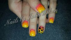 Pink.  Orange.  Yellow.  Ombre nails.