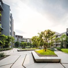 Excellent use of isolated specimens and small groups in the garden of these residential blocks. In Lands-Design, use command Plant (instead of Plant Row, Forest or Parterre), like in http://www.lands-design.com/features/vegetation/