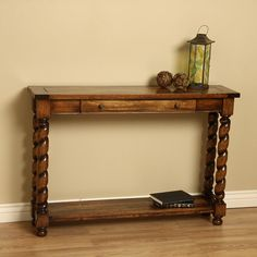 Beautify your living space with this stylish wood console table. Featuring a unique swirl design, this handcrafted piece has intricate details that enhance its aesthetic value. Its large drawer and bottom shelf provide an area for you to store items.