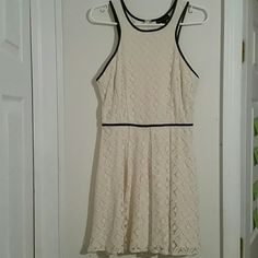 Cream lace short dress. Very cute cream colored lace dress. The black lining is a leathery material on the dress. Its a Very lovely dress!! Dresses Mini