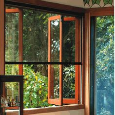 Timber WRC Bifold Windows with roll down flyscreen