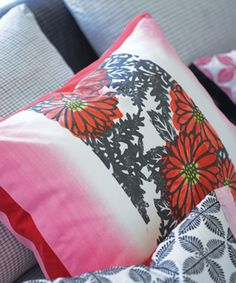 Ikebana cushion with a beautiful graphic print softened by peony pink shades