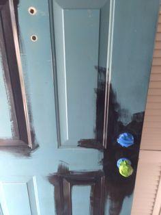 DIY home improvement. How to paint a front door. Painting a metal door. Painting metal. Black front door.