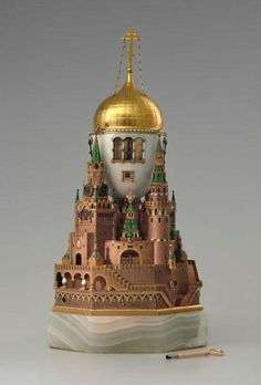 """Easter egg """"The Moscow Kremlin"""" Russia, Saint-Petersburg, 1904-1906. Fabergé firm. Gold, silver, glass, onyx, mica, fabric, base metal; casting, enamel, engraving, guilloche, granulation, oil painting. Presented by Emperor Nicholas II to Empress Alexandra Fyodorovna for Easter 1906."""