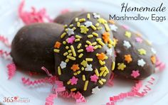 Homemade marshmallow eggs - make own recipe without corn syrup and simply cookie cutter out egg shapes and cover with chocolate.
