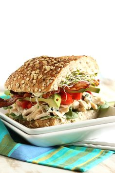 Inspired by the Cobb Salad, this sandwich is bursting with flavor! Jam packed with roasted chicken, gorgonzola, avocado, sprouts and bacon.this is the perfect sandwich for sharing. The Suburban Soapbox Gourmet Sandwiches, Gourmet Burger, Sandwiches For Lunch, Soup And Sandwich, Wrap Sandwiches, Sandwich Recipes, Salad Sandwich, Slow Food, Food Styling