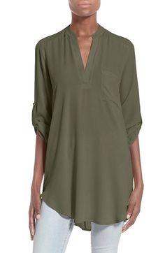 Free shipping and returns on Lush 'Perfect' Roll Tab Sleeve Tunic at Nordstrom.com. A long, swingy silhouette brings graceful movement to a smooth split-neck tunic styled with roll-tab sleeves and a high/low hem.