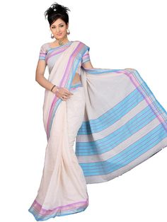 This stylish cream colored cotton saree adorned blue and pink border gives it a mindblowing look.  This saree will add zing to your fiesta in a passionate way. (Slight variation in color is possible)