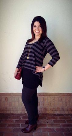This new top is one piece that looks like two pieces! Grey/black stripe boxy top connected to long black layering piece. Love this over leggings and our oxblood booties! Open till 6!