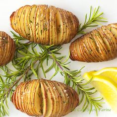 Hasselback Potatoes w/ Garlic, Lemon & Rosemary - substitute butter to make it Vegan (even olive oil is yummy!)Made with Mix Party Gourmet garlic and rosemary balsamic! Potato Dishes, Potato Recipes, Food Dishes, Vegan Recipes, Cooking Recipes, Side Dishes, Lemon Potatoes, Rosemary Potatoes, Hasselback Potatoes