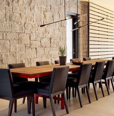 Contemporary Dining Room Design Ideas With Gray Texas Lueders Limestone Wall And Timber Dining Table And Black Upholstered Wood Dining Chairs: Contemporary Ski Shores Lakehouse by Stuart Sampley Architect