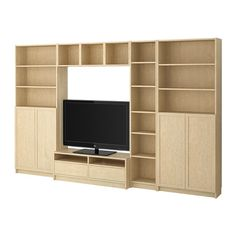 BILLY/BENNO TV storage combination IKEA Veneered surface; gives a natural look and feel. Cord outlet in the back.  Keeps all cords in one place.