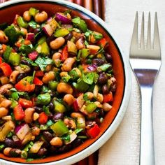 Bean Salad...AMAZING!  1 can Black Eyed Peas  1 can Black Beans  1 can Shoe Peg Corn  3 each MINI Sweet Peppers-Yellow, Orange, Red  Chopped Handful of Cilantro  Bunch of Greens Onions  Bottle of Zesty Fat Free Italian Dressing.  Drain beans,peas and corn. Dump in bowl. Add all other ingredients. Marinate over night or at least 6 hours. Strain. Serve with chips or as a side dish or filling for tacos. khealy26