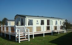 Fensys static caravan decking with tinted toughened glass panels Plastic Fencing, Decking Suppliers, Caravan Holiday, Led Manufacturers, Park Homes, Galvanized Steel, Glass Panels, Sunroom, Fence