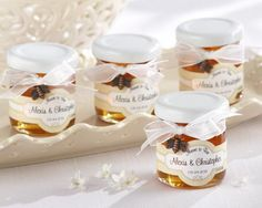 """Meant to Bee"" Honey Wedding Favor Set includes 12 jars of gourmet Grade A clover honey. It is pure and natrual with additives, preservatives, or residues. It comes in a plastic jar with a white screw off cap. It comes wrapped in a white organza bow with a bronze bee charm. You can personalized this item with a honeycomb pattern, gold and white label."