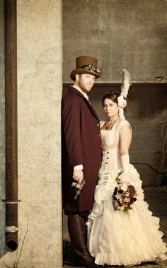 Steampunk Bride and Groom in Steampunk Wedding #steampunko #steampunk #steam #steampunkphoto #steampunkcouture  #steampunkbride #brides #wedding #white #hat #steampunkwedding #weddingdress #groom #steampunkgroom