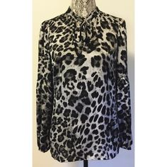 Michael Kors silky leopard blouse Brand new leopard blouse with trumpet-style sleeves and self-tie in front. Size XS. 100% poly Michael Kors Tops Blouses