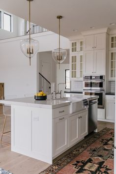 BECKI OWENS- Villa Bonita Kitchen Reveal! White and wood kitchen, mix metals, Brizo Artesso Bridge Faucet.