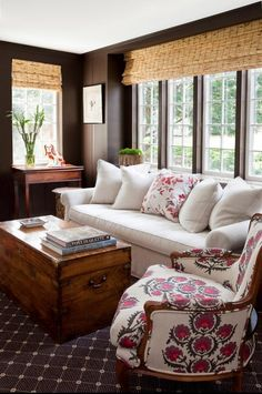 dark walls, brown paint, bamboo roman shades, pattern chairs, french chair, trunk coffee table