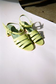 "From the coveted design collection of contemporary fashion icon and NYC  boutique owner Maryam Nassir Zadeh comes this wasabi green colored leather  sandal. The foot is enveloped in soft leather cross toe straps and finds  balance on two inch stacked wooden heels and rounded toe. Finished with  adjustable ankle straps and petite leather enclosed buckle. By Maryam  Nassir Zadeh 100% Leather2"" heelRuns true to size.Questions about this  product? Email hello@lisasaysgah.com, call us 415.757..."