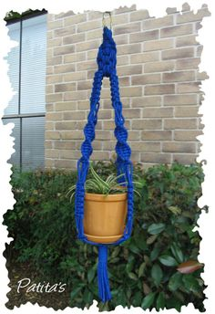 Deep Blue Macrame Plant Hanger by PatitasCrafts on Etsy, $20.00  -- Gorgeous. Great colour if you know how to make it ;)