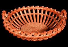 Earthenware pierced pottery basket with Iron red glaze.