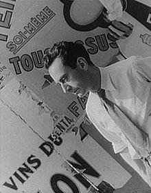 Man Ray, photographed at Gaite-Montparnasse exhibition in Paris by Carl Van Vechten on June 16, 1934