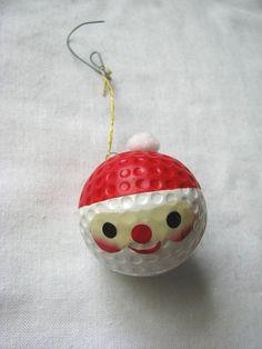 Vintage painted  Santa face golf ball holiday ornament. $5.99, via Etsy.