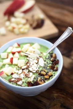 This easy green smoothie bowl is creamy from the avocado and packed full of healthy greens and fruits. Top it with almonds, chia seeds and chopped fruit for the perfect start to your day!