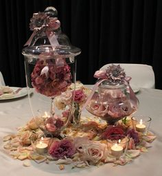Romantic vintage wedding centerpiece idea.    This is one of our romantic wedding centerpieces where we used jars to hold the flowers for this very special day.