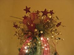 Great tutorial on how to make a tree topper bow...