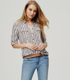 In an off-the-grid plaid, roll tab sleeves give this refined essential its modern attitude. Collared. Long sleeves. Button front. Flap patch pockets. Button-through roll tabs at sleeves. Button cuffs. Shirttail hem. Pleated beneath back yoke.