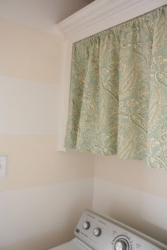 Curtain in laundry room - would be good to hide our ugly utility box