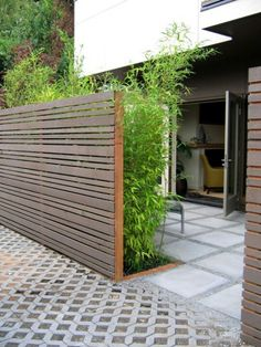 Modern Fences – Use your imagination horizontal fence design & planning and the bamboo plants add to the privacy! Possibility for front yard to protect front door from wind.