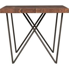 Sustainable Solid Shesham wood planks are perched on a iron W base.  Dylan Dining Table, $1,000. Cb2