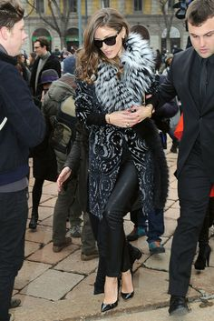 At Milan Fashion Week, Olivia made her way into the Roberto Cavalli show in a totally glammed-up take on leather bottoms, with a brocade coat and a fur collar to finish.