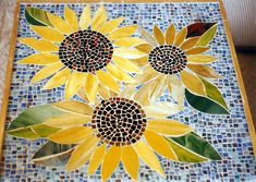 A mosaic coffee table. Made of stained glass that I pre-cut then heated to slightly melt off the sharp edges. Mosaic Tray, Mosaic Tile Art, Mosaic Pots, Mosaic Crafts, Mosaic Projects, Stone Mosaic, Mosaic Glass, Mosaics, Stained Glass
