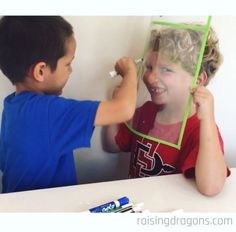 Drawing portraits is a fun partner activity is a great way to get kids having fun with art while learning to draw portraits. drawing dragon Drawing Portraits on Sheet Protectors * ages 4 ⋆ Raising Dragons Educational Activities For Kids, Toddler Activities, Learning Activities, Kids Learning, Preschool Art, Kindergarten Activities, Art Montessori, Montessori Elementary, Toddler Play