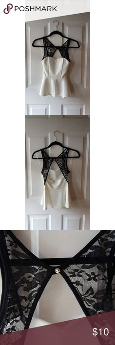 Peplum top White peplum top with black lace detailing. Charlotte Russe Tops