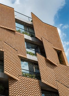 Image 6 of 19 from gallery of Saadat Abad Residential Building / Mohsen Kazemianfard - fundamental approach architects. Photograph by Parham Taghioff Architecture Paramétrique, Contemporary Architecture, Brick Design, Facade Design, Building Facade, Building Design, Teheran, Brick Facade, Architectural Elements