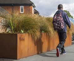 Bespoke steel planters are commissioned for a walking route scheme in Colchester Town Centre. Corten Steel street planters ideal for public realm.
