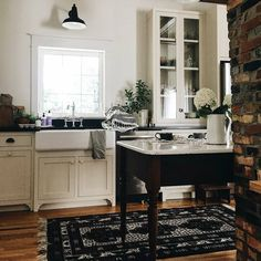 Sharing another favorite kitchen inspiration! This beautiful space belongs to Morgan @thewhitefarmhouseblog whitefarmhouseblog. If you love a good love story, hers is great! I love the white inset shaker cabinets, the wood floor and the black accents. She put a lot of taste into her small space. My kitchen is also an L shape with not a lot of options. We hope to find some type of antique to work as an island, and Morgan's table looks great. I don't know yet when our kitchen will get done…