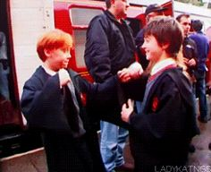 Tiny Ron and Harry play fighting on set: