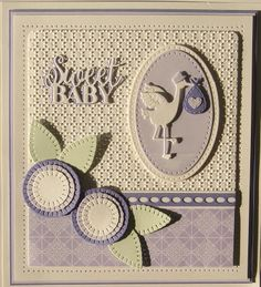 Good Sunday morning all! I have two simple cards to share with you today, both using the Stork and Baby die set. For this first card, I embossed a piece of coconut white card with the Dotted Matrix