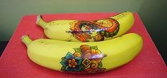 temporary tattoos on the kids' lunchbox bananas. Why teach children to eat their food, when you could instead  encourage them to show off their food, play with their food, and keep their food intact, perhaps in their desk at school for a month.