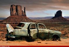 rusty car against a rusty background,Abandoned in Monument Valley, Arizona.