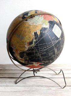 We love vintage black globes and think he will, too.  Black Globe on Metal Stand.