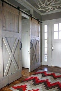 barn doors instead of hanging blinds over the sliding glass door I am totally building this and hanging this over the door.